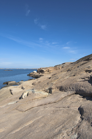 Fantastic day in the archipelago, Sweden. Beautiful summer season specific photograph. Summer archipelago with beautiful sunlights and waves. Lovely lights and colors. Summer environment.