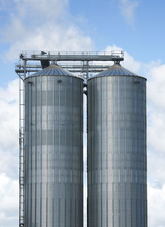 mass storage: Silos, two large silos and sky background