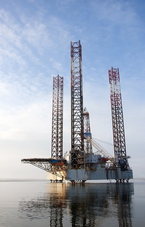 Offshore oil rig with blue sky background  photo