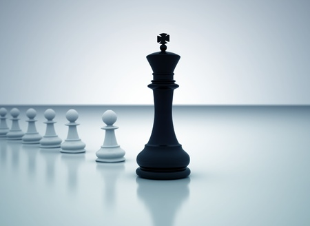 leading: Leadership concept - Chess king leading the pawns
