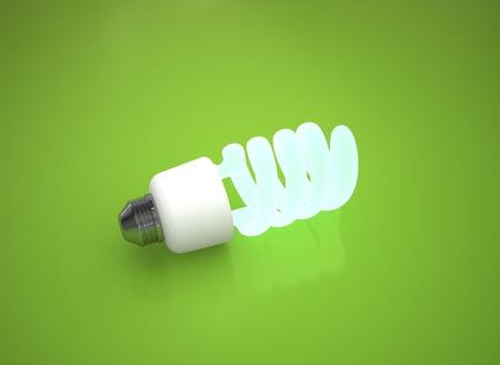 energy saving light bulb on green background photo