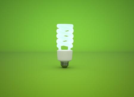 modern energy-saving lightbulb lit on a lush green background Stock Photo - 8248954