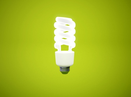 energy saving light bulb on green background Stock Photo - 8378392