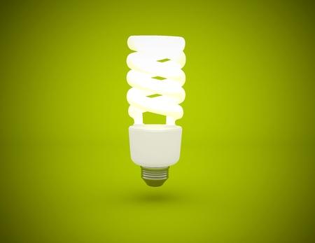 effizient: Gl�hbirne leuchtet auf gr�n hintergrund