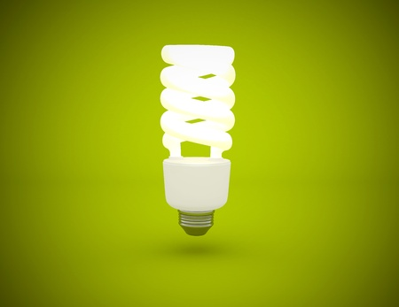 Light bulb lit on green background photo