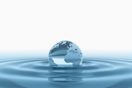 the natural world: World globe in water  Stock Photo