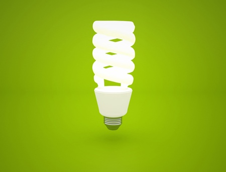 glowing Light bulb idea on green background photo