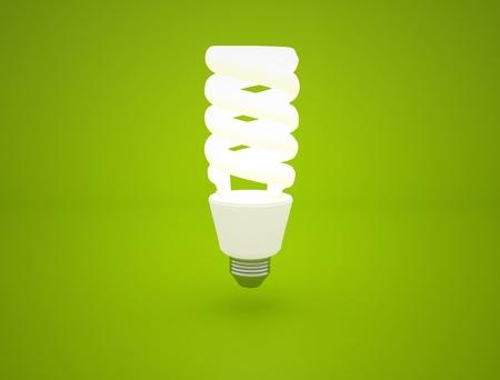 glowing Light bulb idea on green background photo