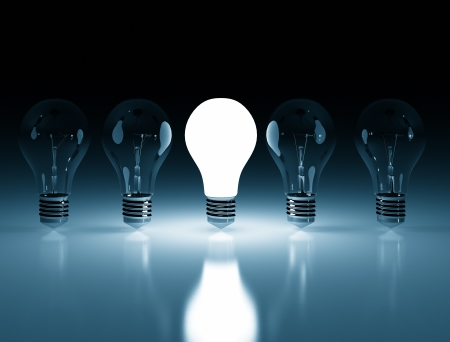 Single lit light bulb Standard-Bild