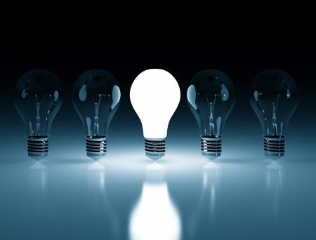 Single lit light bulb Stock Photo