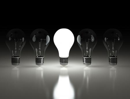 Row of light bulbs one lit  photo