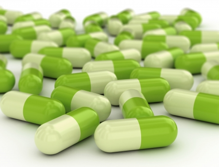Green pills - medical background photo