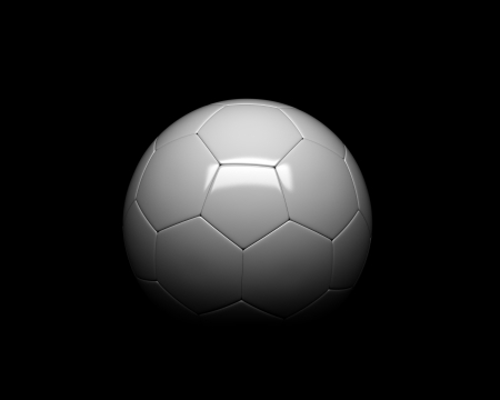 Soccer ball half lit black background photo