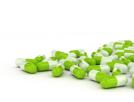 Green pills on white background Standard-Bild