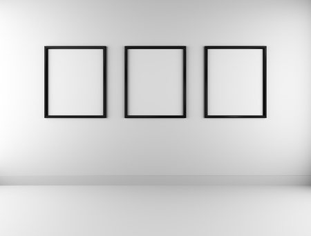 Three blank picture frames on wall photo