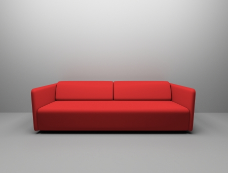 Red sofa up against blank wall