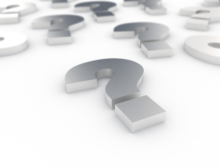 inquiring: group of metal question marks on white background  Stock Photo