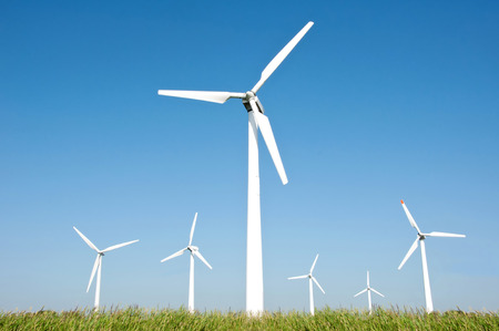 Wind turbine farm and blue sky background  photo