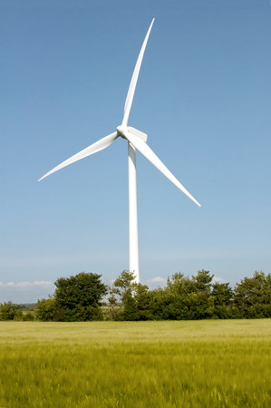 wind force wheel: Wind turbine on the beautiful autumn meadow