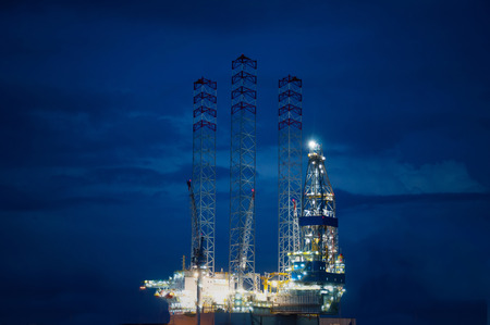 oil industry: Off shore oil rig at night Stock Photo