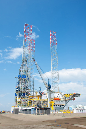 steel tower: Oil rig in habourfor repairs Stock Photo