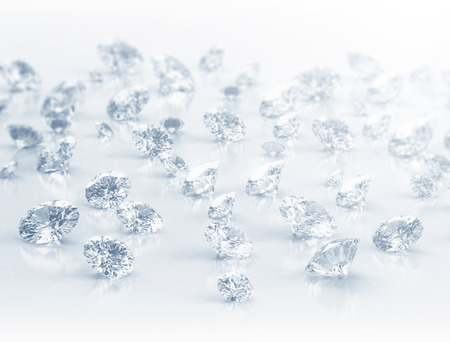 Large group of diamonds close up on white background