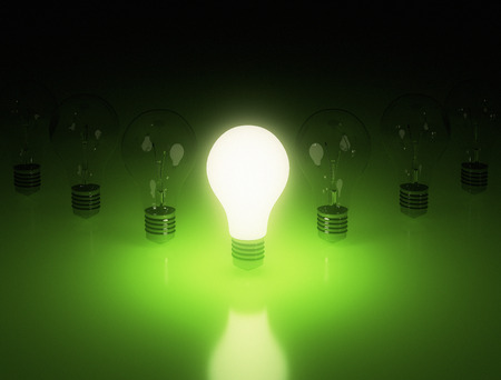 row: Row of light bulbs on green background