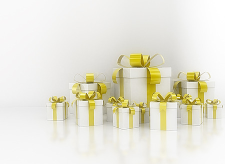 white boxes: Group of white and golden yellow ribbon gift boxes Stock Photo