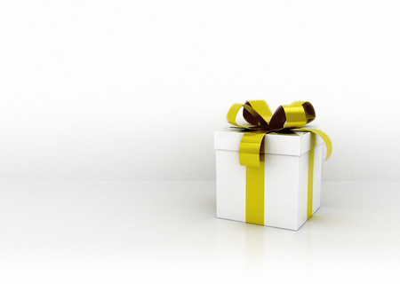 gift ribbon: Single white and gold ribbon gift box against white wall Stock Photo