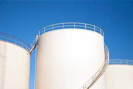 Fuel storage tanks and blue sky Stock Photo