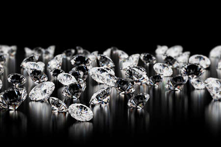 large group of diamonds on black background. Close up image