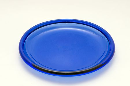 A blue glass plate on a white background.