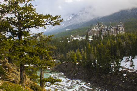 Panoramic view of a hotel in the forest at Surprise Corner, near Banff, in Alberta, Canada.