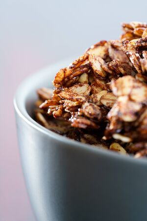 Macro shot of homemade cocoa granola with crunchy peanuts and maple syrup. Morning light, high resolution Stockfoto