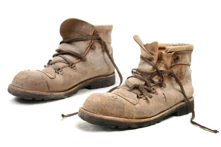 pigskin: Dirty old brown pigskin leather work boot, very worn, with metal reinforcements to the sole Stock Photo