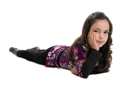 children acting: girl lying down isolated  on white background