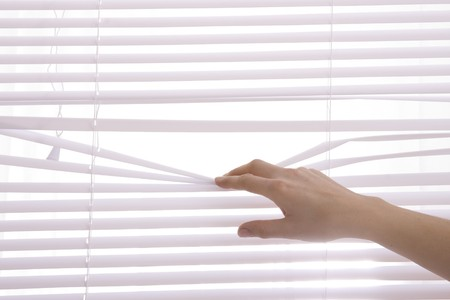 security shutters: hands apart on the window blinds