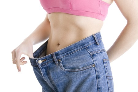Woman show how much weight she lost Stock Photo - 4507077