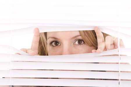 woman hands apart on the window blinds Stock Photo - 6535650