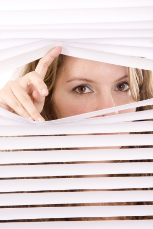 woman hands apart on the window blinds Stock Photo