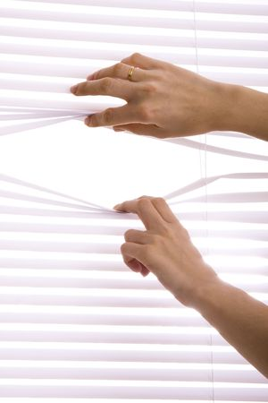 open girl: hands apart on the window blinds.