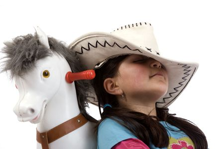 cowgirl sleep with toy horse photo