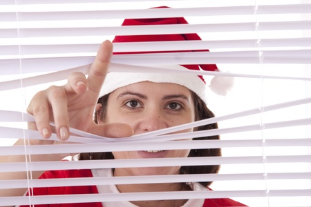 mrs  claus: Mrs. Santa Claus hands apart on the window blinds