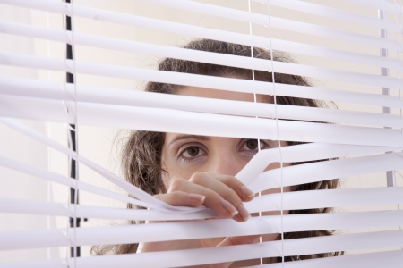 blind people: hands apart on the window blinds