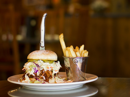 Pulled pork and coleslaw sandwich with garlic fries photo