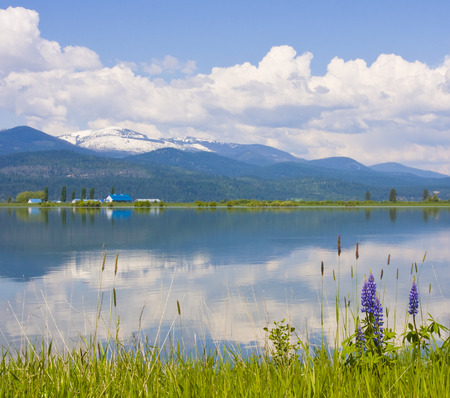 Pend Oreille River Reflection of Clouds, Selkirk Mountains