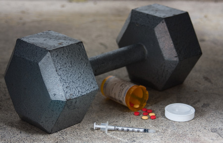 Dumbbell with Steroids and Needle Imagens