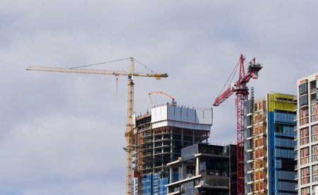 Cranes Constructing Commercial Office Buildings 스톡 콘텐츠