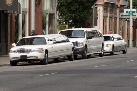 Horizontal Photo of Three Limousines parked on a street