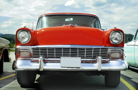 classic car: Horizontal Photo of a 1956 Chevy Nomad Wagon Red Classic Car with Chrome Chevrolet Editorial